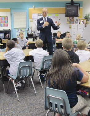 J. STEELE OLMSTEAD talks with third-graders at Suncoast Elementary School as part of the Justice Teaching program.